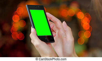 Woman using smartphone with green screen - Woman using...