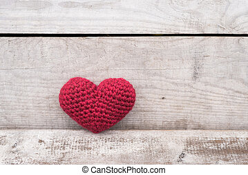 Crocheted heart on a grunge background