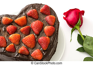 Heart shaped cake and rose for Valentine's Day or mother's day isolated on white background