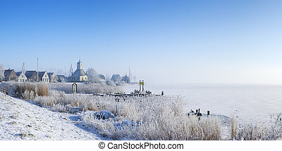 The village of Durgerdam, Netherlands in a frozen landscape...