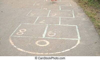 Child playing hopscotch at the kindergarten