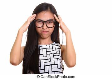 Young Asian teenage nerd girl having headache
