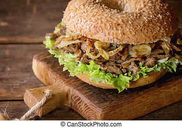Bagel with stew and fried onion - Bagel with stew beef,...