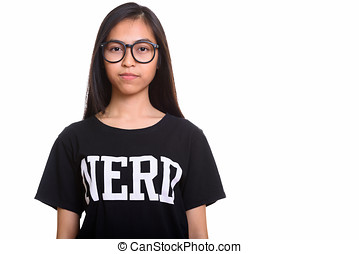 Studio shot of young Asian teenage nerd girl
