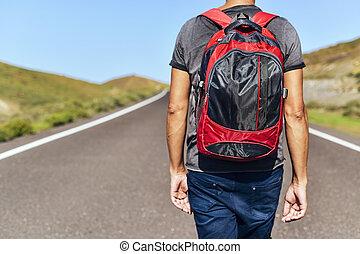 young backpacker man - closeup of a young caucasian man seen...