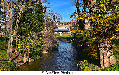 Aude river and Pont Vieux bridge in Carcassone, France - a...