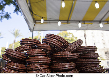 Chocolate coated spanish churros and porras ready to be...