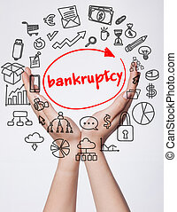 Technology, internet, business and marketing. Young business woman writing word:Bankruptcy
