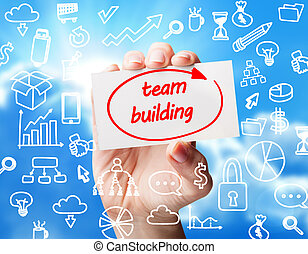 Technology, internet, business and marketing. Young business woman writing word: team building