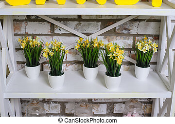 yellow daffodils flowers in pots on a table