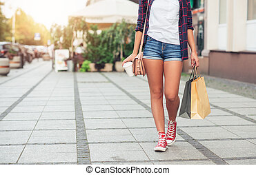 Young woman walking and shopping in the city -...