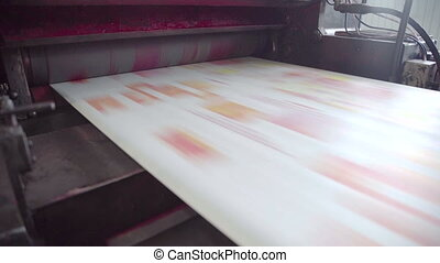 Printed red color on printing machine to make newspaper in factory
