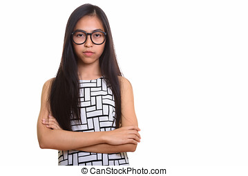 Young Asian teenage nerd girl with arms crossed