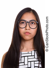 Face of young Asian teenage nerd girl thinking