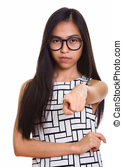 Young Asian teenage nerd girl pointing finger at camera