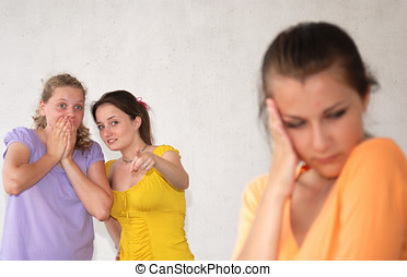 Sad girl - Two teenage girls pointing at their friend....