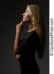 profile portrait of a young girl positive thinking and...