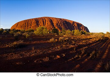 Monolith of Uluru on rising. - Uluru. A monolith of Uluru on...