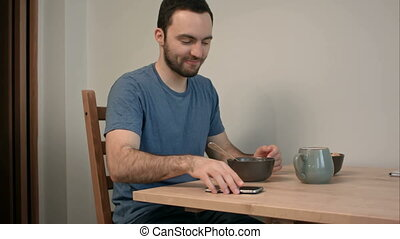 Young man taking photo of breakfast using smartphone