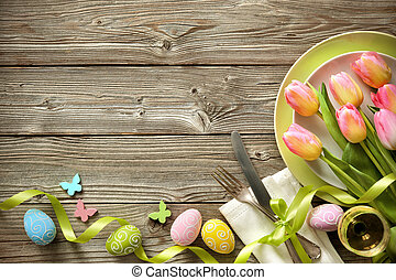 Easter table setting with spring tulips and cutlery
