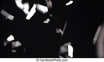 silver confetti falling over black background - party,...