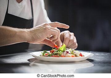 Chef hands preparing vegetable salad - Close up portrait of...