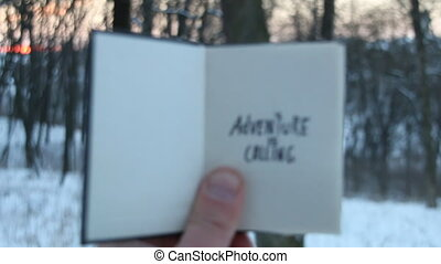 Adventure is calling, travel idea. Book and Hand written...