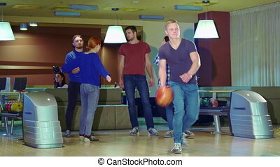 Friends high-fives man after his release at the bowling -...