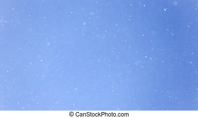 Snow in blue sky