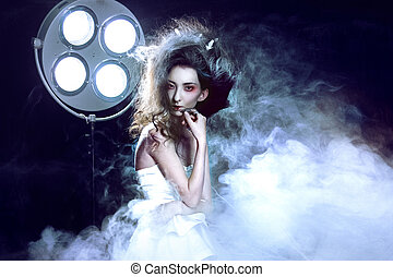 Young attractive girl as a Ghost, a lot of smoke, hospital...