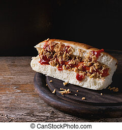 Homemade hot dog with sausage, fried onion and ketchup...
