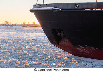Icebreaker in the river ice. Nose of ship. - Icebreaker in...