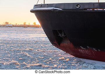 Icebreaker in the river ice. Nose of ship. - Icebreaker in...