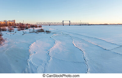 Frozen river Northern Dvina and Railway bridge in...