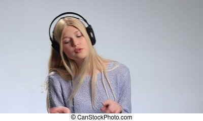 Emotional woman with headphones listening to music