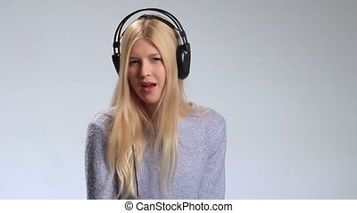 Expressive girl in headphones listening to music