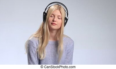 Beautiful woman with headphones listening music - Music...