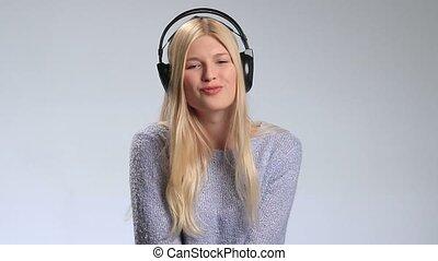 Emotional girl in headphones listening to music - Emotional...