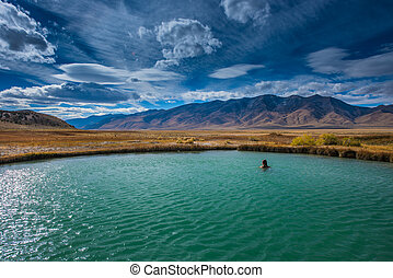 Hot Springs Nevada Ruby Valley Woman enjoying a soak -...