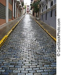 cobblestone road uphill in san juan