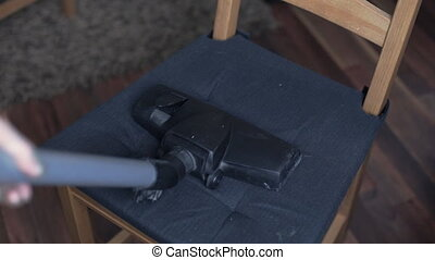 Cleaning dirty chairs using vacuum cleaner