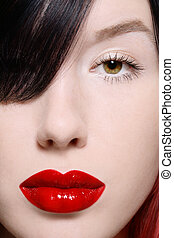 Eye and lips - Close-up shot of beautiful woman face with...