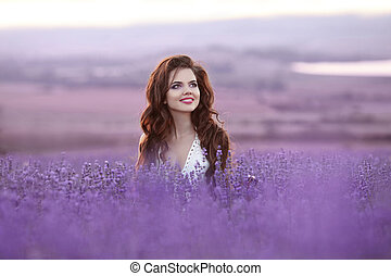Beautiful young woman portrait in lavender field. Attractive...