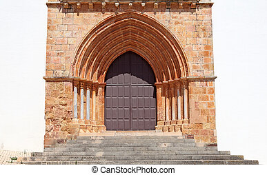 Gothic door of an ancient cathedral in Portugal