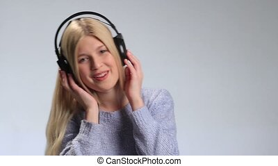 Pretty hipster girl going crazy of favorite music -...