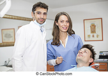 Young man having dental chekup at dentist office