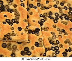 focaccia bread with a lot of slices of olives from the...