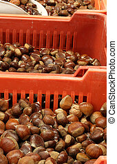 boxes full of chestnuts for sale - crates of ripe chestnuts...