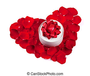 Red rose petals heart with gift box. Isolated on white...