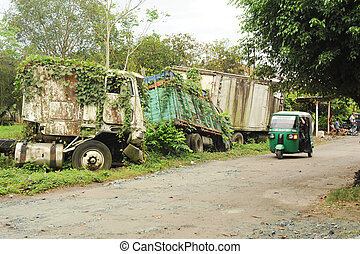 Abandoned truck wreck and train wagon at Quirigua